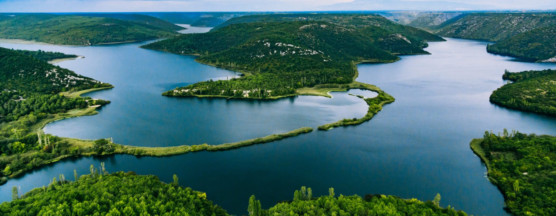 Aerial view of blue lakes and green forest. Krka river national park, Dalmatia, Croatia
