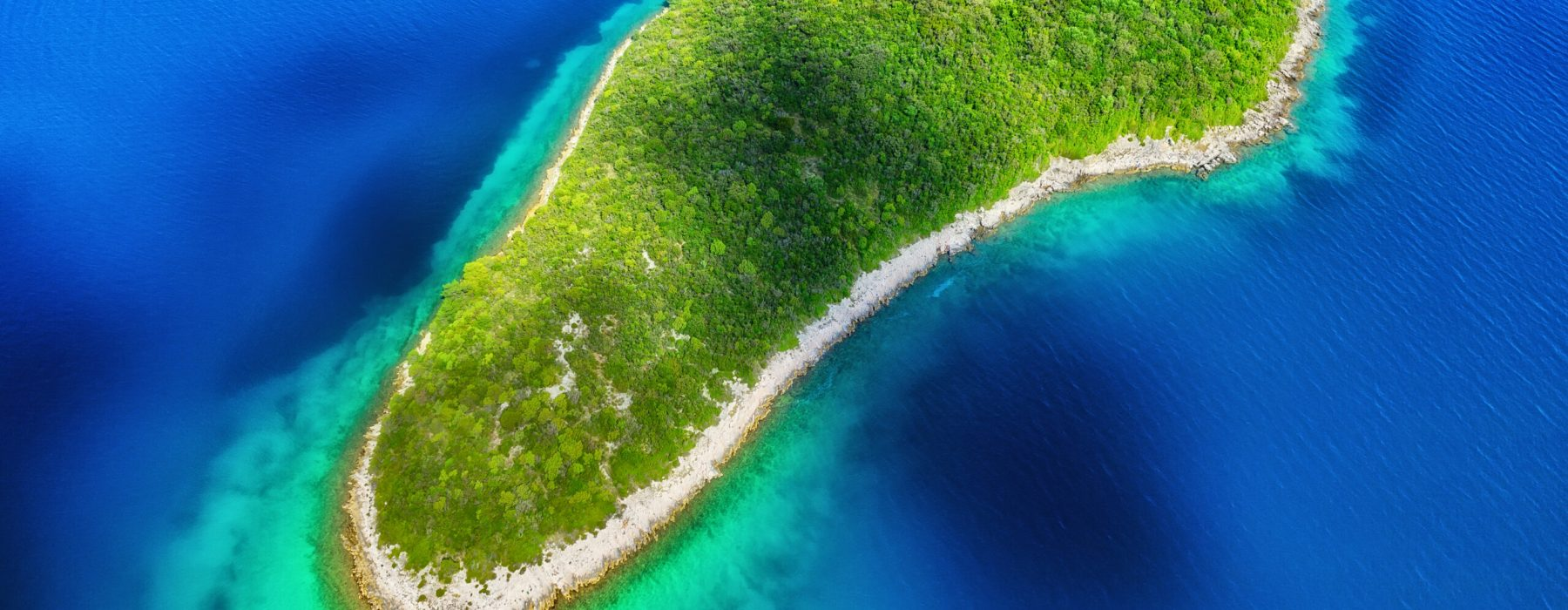 Island in the sea in Croatia. Aerial view on island with forest. Adriatic sea, Croatia. Seascape from drone at the summer time. Travel and holiday